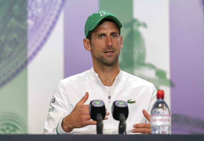 Novak Djokovic attends a press conference after winning the men's final against Italy's Matteo Berrettini at the Wimbledon Tennis Championships in London, Sunday, July 11, 2021. (Joe Toth/Pool via AP)