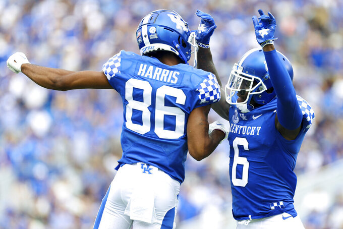 Kentucky wide receivers Josh Ali (6) and DeMarcus Harris (86) celebrate after a touchdown during the first half of a NCAA college football game against Chattanooga in Lexington, Ky., Saturday, Sept. 18, 2021. (AP Photo/Michael Clubb)
