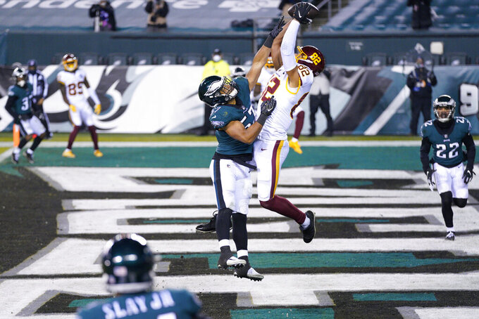 Washington Football Team's Logan Thomas (82) catches a touchdown against Philadelphia Eagles' T.J. Edwards (57) during the first half of an NFL football game, Sunday, Jan. 3, 2021, in Philadelphia. (AP Photo/Chris Szagola)