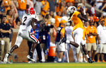 Tennessee wide receiver Marquez Callaway (1) catches a pass en route to a touchdown as he is defended by Georgia defensive back Richard LeCounte (2) in the first half of an NCAA college football game Saturday, Oct. 5, 2019, in Knoxville, Tenn. (AP Photo/Wade Payne)