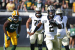 New Orleans Saints quarterback Jameis Winston (2) scrambles for yardage as Green Bay Packers linebacker Jonathan Garvin (53) gives chase during the first half of an NFL football game, Sunday, Sept. 12, 2021, in Jacksonville, Fla. (AP Photo/Stephen B. Morton)