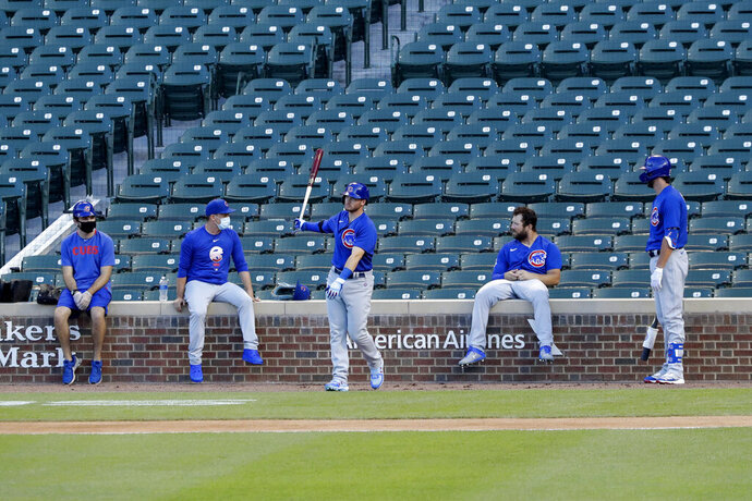 Chicago Cubs players attend baseball practice at Wrigley Field in Chicago, Friday, July 10, 2020. (AP Photo/Nam Y. Huh)