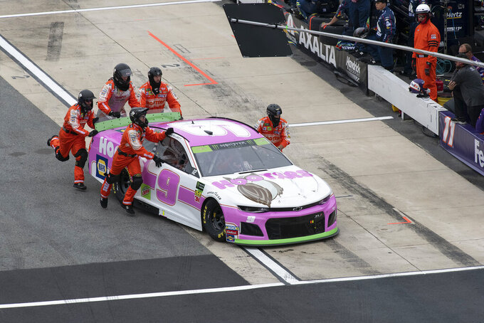 Chase Elliott's team pushes his car down pit road due to engine trouble at the Drydene 400 - Monster Energy NASCAR Cup Series playoff auto race, Sunday, Oct. 6, 2019, at Dover International Speedway in Dover, Del. (AP Photo/Jason Minto)