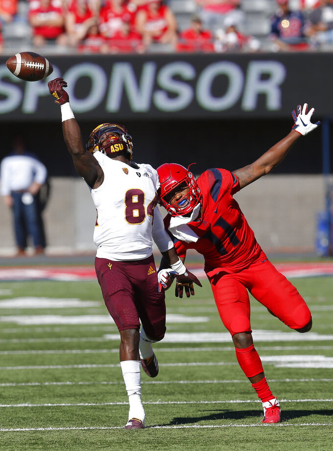 Arizona safety Troy Young (11) gets called for holding Arizona State wide receiver Frank Darby (84) in the first half during an NCAA college football game, Saturday, Nov. 24, 2018, in Tucson, Ariz. (AP Photo/Rick Scuteri)