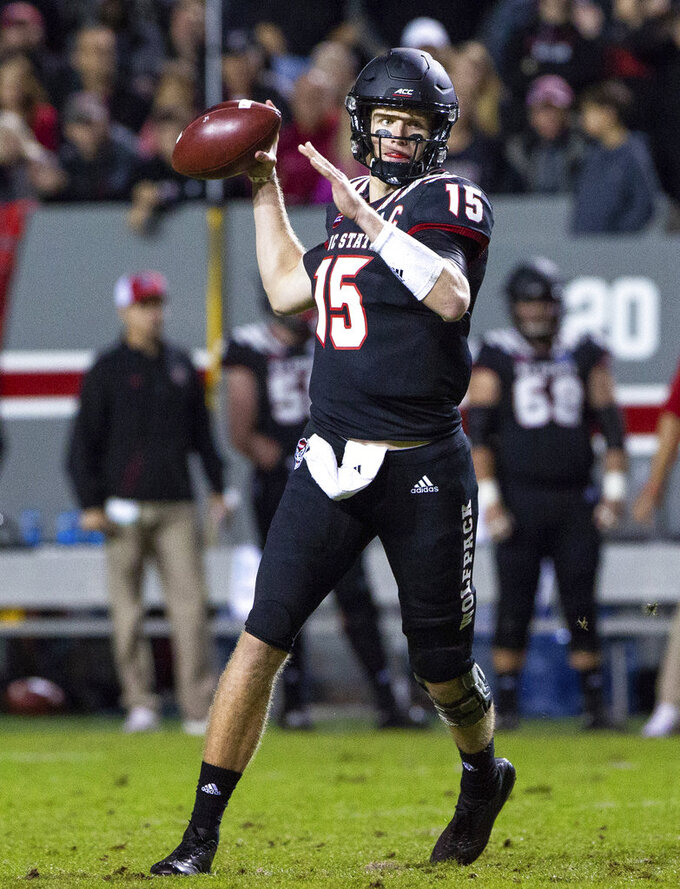 North Carolina State quarterback Ryan Finley (15) looks to pass during the first half of an NCAA college football game against Wake Forest in Raleigh, N.C., Thursday, Nov. 8, 2018. (AP Photo/Ben McKeown)