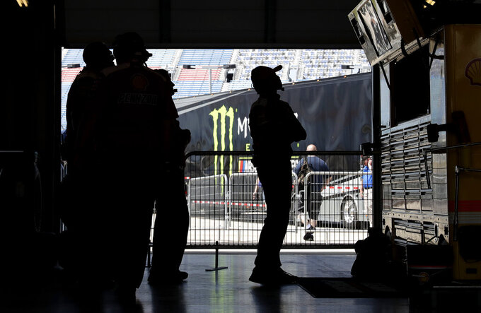 Crew members for Joey Logano check monitors during a practice for the NASCAR Sprint Cup Series auto race at Chicagoland Speedway in Joliet, Ill., Saturday, June 29, 2018. (AP Photo/Nam Y. Huh)