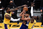 Los Angeles Lakers' LeBron James, left, and Dennis Schroder, right, defend against Golden State Warriors' Stephen Curry during the second half of an NBA basketball game, Monday, Jan. 18, 2021, in Los Angeles. (AP Photo/Jae C. Hong)