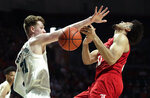 Louisville forward Jordan Nwora, right, loses control of the ball as Miami forward Sam Waardenburg (21) defends during the first half of an NCAA college basketball game, Tuesday, Nov. 5, 2019, in Coral Gables, Fla. (AP Photo/Lynne Sladky)