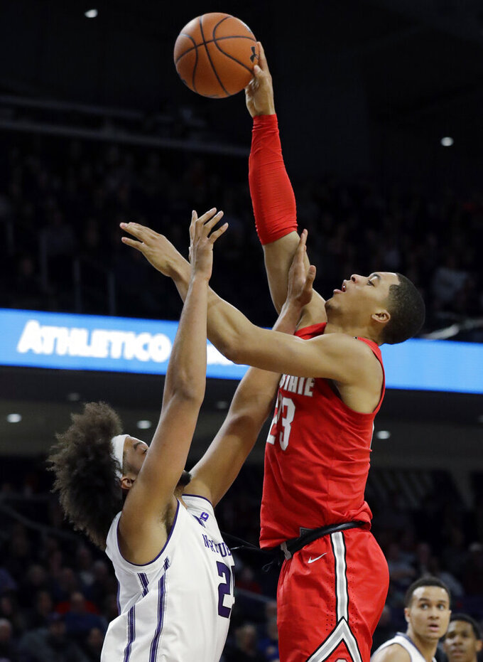 Ohio State forward Jaedon Ledee, right, shoots over Northwestern center Barret Benson during the first half of an NCAA college basketball game Wednesday, March 6, 2019, in Evanston, Ill. (AP Photo/Nam Y. Huh)