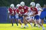 Indianapolis Colts quarterback Carson Wentz (2), along with fellow quarterbacks Jacob Eason (9), Sam Ehlinger (4), and Brett Hundley (3) run a drill during practice at the NFL team's football training camp in Westfield, Ind., Monday, Aug. 23, 2021. (AP Photo/Michael Conroy)