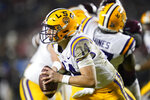 LSU quarterback Max Johnson (14) looks to run against Texas A&M during the third quarter of an NCAA college football game, Saturday, Nov. 28, 2020, in College Station, Texas. (AP Photo/Sam Craft)