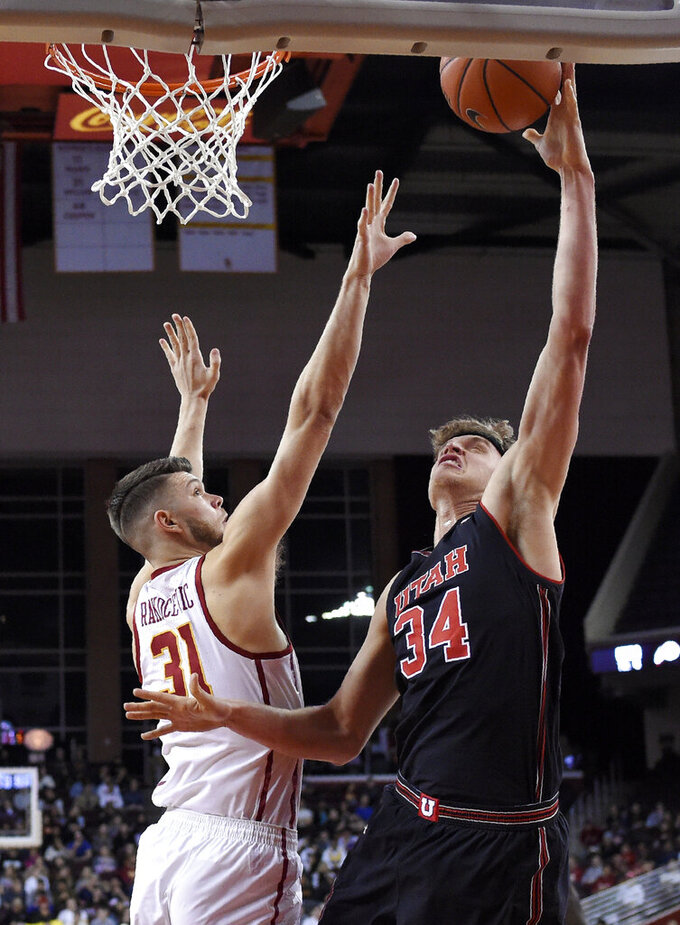 Utah Utes center Jayce Johnson, right, shoots as Southern California forward Nick Rakocevic defends during the first half of an NCAA college basketball game Wednesday, Feb. 6, 2019, in Los Angeles. (AP Photo/Mark J. Terrill)