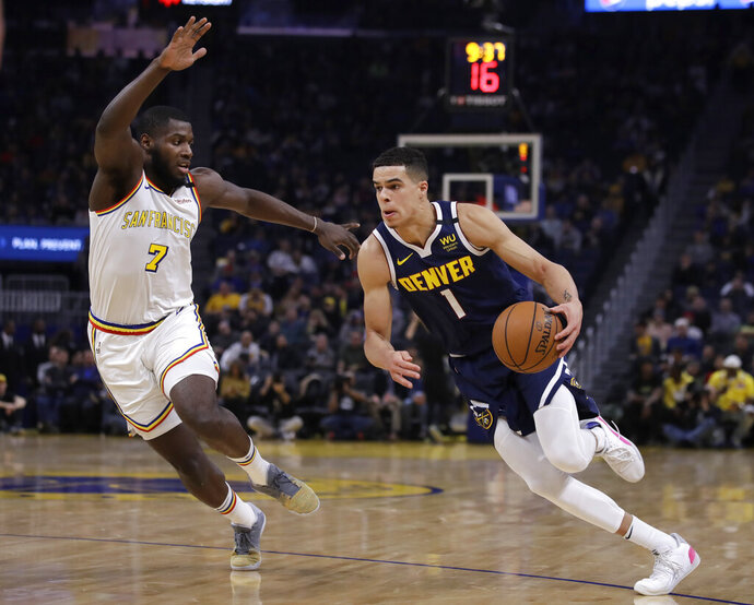 Denver Nuggets' Michael Porter Jr., right, drives the ball against Golden State Warriors' Eric Paschall (7) during the first half of an NBA basketball game Thursday, Jan. 16, 2020, in San Francisco. (AP Photo/Ben Margot)