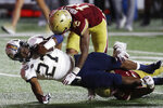 Boston College defensive back Brandon Sebastian (10) and defensive back Deon Jones, bottom right, tackle Georgia Tech running back Jordan Mason (27) during the second half of an NCAA college football game, Saturday, Oct. 24, 2020, in Boston. (AP Photo/Michael Dwyer)