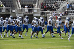 Hampton football players take the field before an NCAA college football game between Howard and Hampton at Audi Field in Washington, Saturday, Sept. 18, 2021. (AP Photo/Cliff Owen)