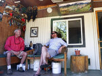In this July 6, 2019, photo Fish Creek Mobile Home Park resident Jeff Morehead, left, visits with Yampa Valley Housing Authority Executive Director Jason Peasley in Steamboat Springs, Colo. Some Colorado towns are taking action to preserve their remaining mobile home parks. Cities, counties and housing authorities, such as the Yampa Valley Housing Authority in Steamboat Springs, are buying mobile home parks to preserve affordable housing for residents as other mom-and-pop park owners sell out to developers or investors. (Matt Stensland/The Colorado Sun via AP)