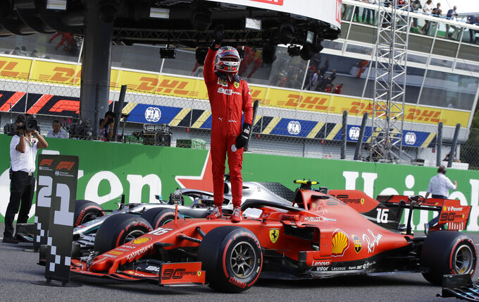 Ferrari driver Charles Leclerc of Monaco celebrates taking pole position during the qualifying session at the Monza racetrack, in Monza, Italy, Saturday, Sept. 7, 2019. The Formula one race will be held on Sunday. (AP Photo/Luca Bruno)