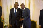 FILE - In this Sept. 17, 2018 file photo, Prime Minister Jean-Henry Ceant, left, and Haiti's President Jovenel Moise, attend the minister's ratification's ceremony at the national palace in Port-au-Prince, Haiti. An American security contractor at the center of a mysterious case roiling Haitian politics says that he and a group of fellow veterans were sent to Haiti on a mission to protect a businessman signing a more than $50 million contract at the country's central bank. (AP Photo/Dieu Nalio Chery, File)