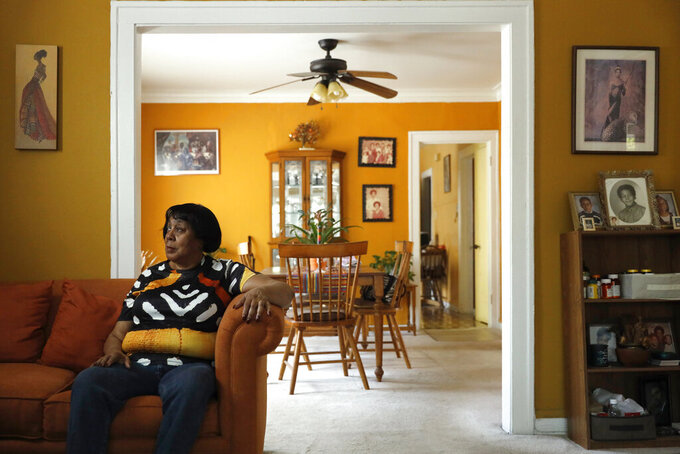 Lifelong Evanston resident Jo-Ann Cromer poses for a portrait in her home in Evanston, Ill., Wednesday, May 5, 2021. The Chicago suburb is preparing to pay reparations in the form of housing grants to Black residents who experienced housing discrimination. Cromer plans on applying. (AP Photo/Shafkat Anowar)