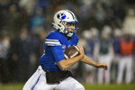 FILE - In this Saturday, Oct. 19, 2019, file photo, BYU quarterback Baylor Romney runs during the first half of the team's NCAA college football game against Boise State in Provo, Utah. It's a three-QB race to run the offense in place of Zach Wilson, who was the No. 2 overall pick by the New York Jets in the NFL draft. (AP Photo/Tyler Tate, File)