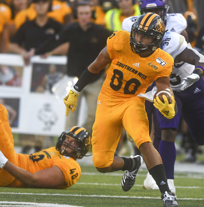 Southern Mississippi wide receiver Jordan Mitchell (80) runs upfield away from Alcorn State defensive end Creo Argue Jr. (38) following a pass reception during the first half of an NCAA college football game, Saturday, Aug. 31, 2019, in Hattiesburg, Miss. (Cam Bonelli/Hattiesburg American via AP)