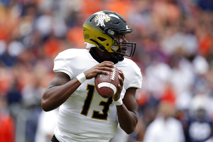 Alabama State quarterback Ryan Nettles (13) looks to throw a pass against Auburn during the first half of an NCAA football game Saturday, Sept. 11, 2021, in Auburn, Ala. (AP Photo/Butch Dill)