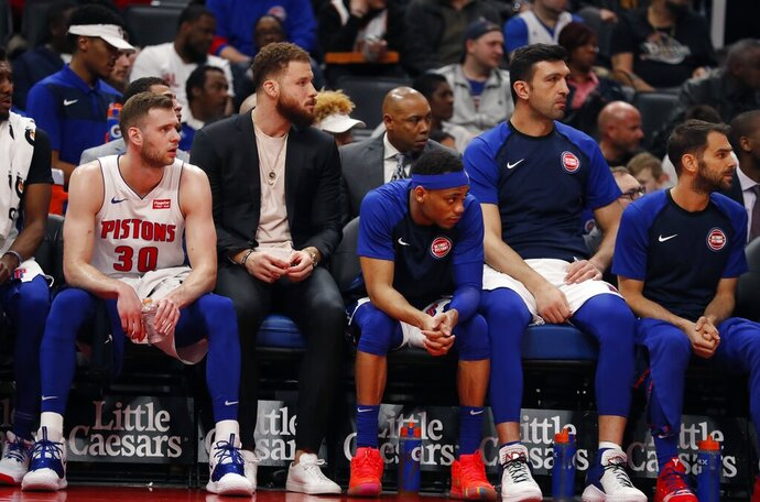Detroit Pistons forward Blake Griffin, second from left, sits on the bench during the second half of an NBA basketball game, Wednesday, April 3, 2019, in Detroit. Griffin sat out for a third game with a sore knee. (AP Photo/Carlos Osorio)