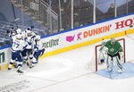 Tampa Bay Lightning center Steven Stamkos, obscured, is congratulated for his goal against Dallas Stars goaltender Anton Khudobin (35) during the first period of Game 3 of the NHL hockey Stanley Cup Final, Wednesday, Sept. 23, 2020, in Edmonton, Alberta. (Jason Franson/The Canadian Press via AP)