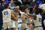 Shawnee State's Latavious Mitchell (25), Donoven Carlisle (30), Tre Beard (12), Amier Gilmore (0) and Issac Abergut (20) celebrate following the final of the NAIA college basketball tournament in Kansas City, Mo., Tuesday, March 23, 2021. Shawnee State defeated Lewis-Clark State. (AP Photo/Orlin Wagner)