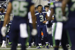 Seattle Seahawks starting quarterback Russell Wilson (3) wears a headset on the sideline during the second half of the team's NFL football preseason game against the Los Angeles Chargers, Saturday, Aug. 28, 2021, in Seattle. Wilson did not play in the game. (AP Photo/John Froschauer)