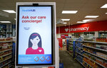 In this Thursday, May 30, 2019 photo, a sign advertises services available at a CVS store with the new HealthHUB in Spring, Texas. HealthHUB locations offer a broader range of health care services, new product categories, digital tools and on-demand health kiosks, trusted advice and personalized care. (AP Photo/David J. Phillip)