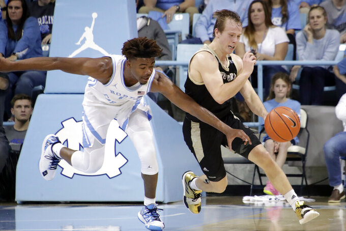 North Carolina's Anthony Harris (0) pressures Wofford's Storm Murphy (5) during the second half of an NCAA college basketball game in Carmichael Arena in Chapel Hill, N.C., Sunday, Dec. 15, 2019. (AP Photo/Chris Seward)