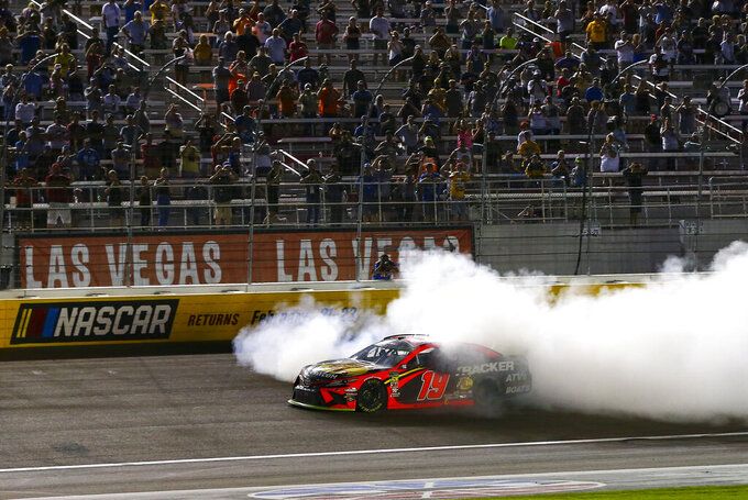 Martin Truex Jr. (19) does a burnout after winning a NASCAR Cup Series auto race at the Las Vegas Motor Speedway on Sunday, Sept. 15, 2019. (AP Photo/Chase Stevens)