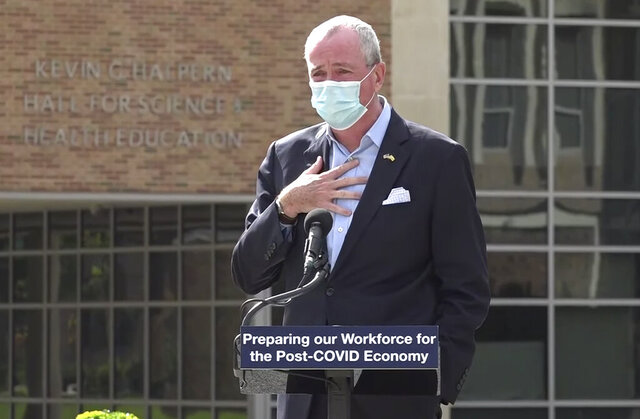 In this photo taken from video provided by the New Jersey Governor's Office, Gov. Phil Murphy tells attendees at an event where he was speaking, Wednesday, Oct. 21, 2020 in Blackwood, N.J., that he must leave the event to quarantine after just finding out that he'd been in contact with someone who had tested positive for COVID-19, (New Jersey Office of the Governor via AP)