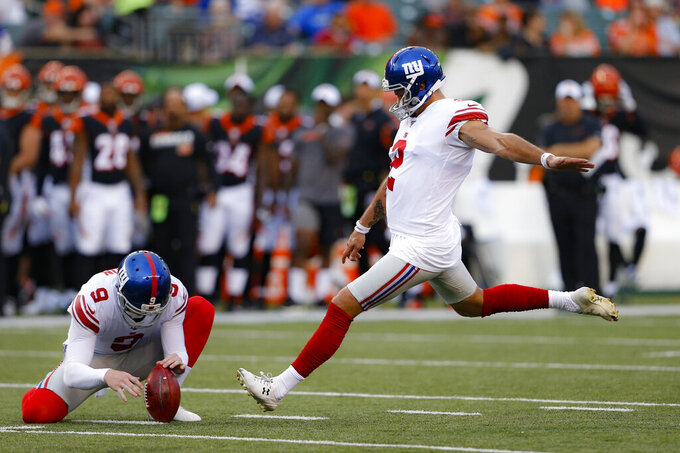 New York Giants' Aldrick Rosas, right, kicks a field goal during the first half of the team's NFL preseason football game against the Cincinnati Bengals, Thursday, Aug. 22, 2019, in Cincinnati. (AP Photo/Gary Landers)