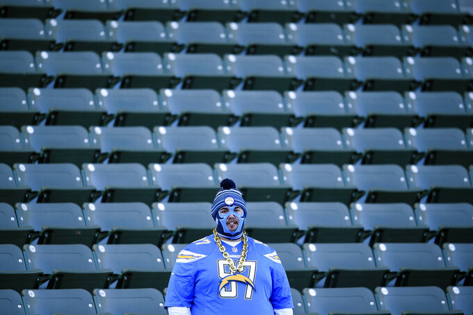 A Los Angeles Chargers fan looks on before an NFL football game against the Minnesota Vikings, Sunday, Dec. 15, 2019, in Carson, Calif. (AP Photo/Kelvin Kuo)