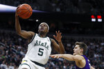 Michigan State guard Cassius Winston (5) makes a layup as Northwestern forward Miller Kopp defends during the second half of an NCAA college basketball game, Wednesday, Jan. 29, 2020, in East Lansing, Mich. (AP Photo/Carlos Osorio)