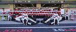 Sauber drivers Marcus Ericsson of Sweden, left, and Charles Leclerc of Monaco pose with the team before the first free practice at the Yas Marina racetrack in Abu Dhabi, United Arab Emirates, Friday Nov. 23, 2018. The Emirates Formula One Grand Prix will take place on Sunday. (AP Photo/Kamran Jebreili)