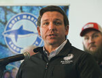 FILE - In this Jan. 10, 2019 file photo, Republican Gov. Ron DeSantis announces funding for his environmental policy during a press conference at Mote Marine Laboratory in Sarasota, Fla. DeSantis and the independently elected Cabinet granted pardons to four African-American men accused of raping a white woman nearly 70 years ago in a case now seen as a racial injustice. The unanimous vote came minutes after alleged victim Norma Padgett Upshaw pleaded with DeSantis and the Cabinet members, meeting as the clemency board, not to grant the pardons, saying she still relives the horror of the rape she said happened in 1949. But DeSantis said the case against the men known as the Groveland Four was clearly mishandled. (Dan Wagner/Sarasota Herald-Tribune via AP, File)
