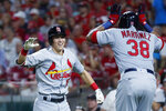 St. Louis Cardinals' Tommy Edman, left, celebrates with Jose Martinez (38) after hitting a grand slam off Cincinnati Reds relief pitcher Robert Stephenson during the sixth inning of a baseball game Thursday, July 18, 2019, in Cincinnati. (AP Photo/John Minchillo)