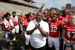 Maryland head coach Michael Locksley, center, celebrates with his team after they beat Howard 79-0 in an NCAA college football game, Saturday, Aug. 31, 2019, in College Park, Md. (AP Photo/Julio Cortez)