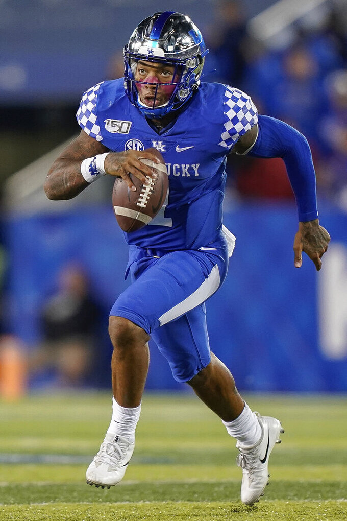 FLE - In this Oct. 12, 2019, file photo, Kentucky quarterback Lynn Bowden Jr. (1) is shown during an NCAA college football game against Arkansas, in Lexington, Ky. Bowden was selected to the AP Midseason All-America NCAA college football team, Tuesday, Oct. 15, 2019. (AP Photo/Bryan Woolston, Fle)