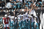 Fans celebrate with Jacksonville Jaguars players after wide receiver Jamal Agnew ran back an Arizona Cardinals missed field goal for a 109-yard touchdown return during the first half of an NFL football game, Sunday, Sept. 26, 2021, in Jacksonville, Fla. (AP Photo/Phelan M. Ebenhack)