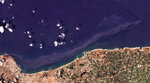 In this satellite photo from Planet Labs Inc., an oil spill is seen stretching off the coast near Baniyas, Syria, Tuesday, Aug. 24, 2021. The massive oil spill caused by leakage from a power plant inside the Baniyas Thermal Station, one of Syria's oil refineries is spreading along the coast of the Mediterranean country, Syria's state news agency said and satellite photos showed Wednesday. (Planet Labs Inc. via AP)