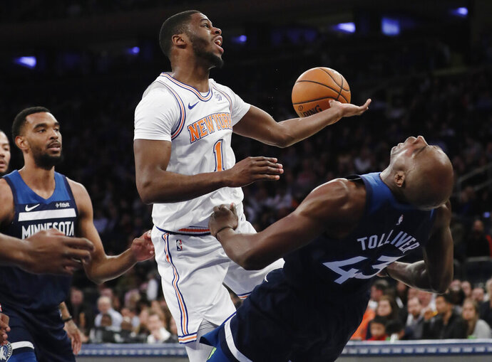 New York Knicks' Emmanuel Mudiay (1) drives into Minnesota Timberwolves' Anthony Tolliver (43) during the second half of an NBA basketball game Friday, Feb. 22, 2019, in New York. The Timberwolves won 115-104. (AP Photo/Frank Franklin II)