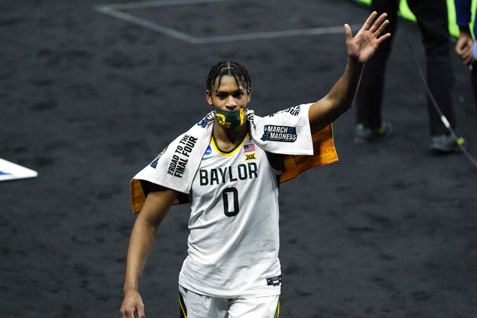 Baylor's Flo Thamba waves to fans as he leaves the court after Baylor defeated Hartford in a college basketball game in the first round of the NCAA tournament at Lucas Oil Stadium in Indianapolis Friday, March 19, 2021, in Indianapolis. (AP Photo/Mark Humphrey)