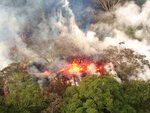 This Wednesday, May 16, 2018, image provided by the U.S. Geological Survey shows lava spattering from an area between active Fissures 16 and 20 photographed at 8:20 a.m. HST, on the lower east rift of the Kilauea volcano, near Pahoa, Hawaii. Plumes range from 1 to 2 kilometers (3,000 to 6,000 feet) above the ground. Officials say some vents formed by Kilauea volcano are releasing such high levels of sulfur dioxide that the gas poses an immediate danger to anyone nearby. (U.S. Geological Survey via AP)