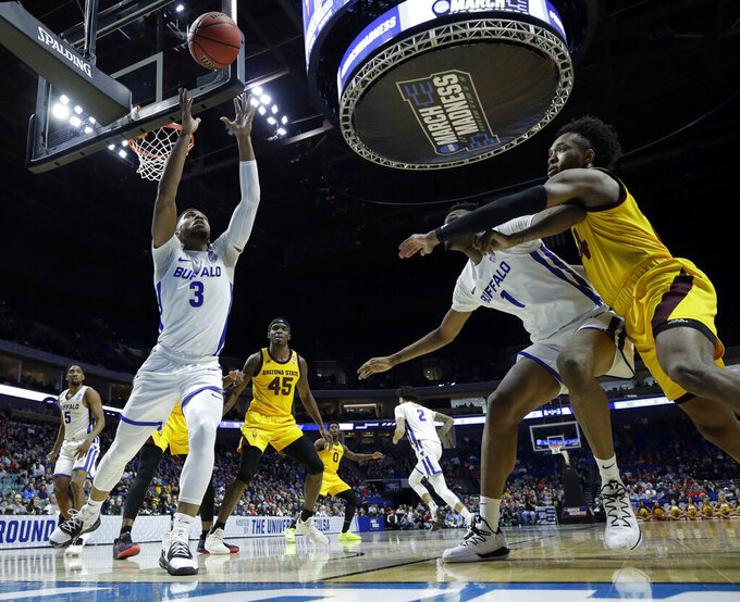 Buffalo's Jayvon Graves (3) grabs a ball before it goes out of bounds during the first half of a first round men's college basketball game against Arizona State in the NCAA Tournament Friday, March 22, 2019, in Tulsa, Okla. (AP Photo/Charlie Riedel)