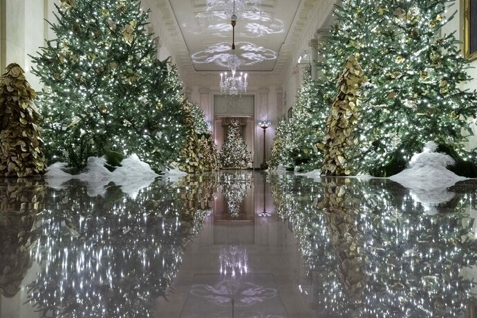 The Cross Hall leading into the State Dinning Room is decorated during the 2019 Christmas preview at the White House, Monday, Dec. 2, 2019, in Washington. (AP Photo/Alex Brandon)