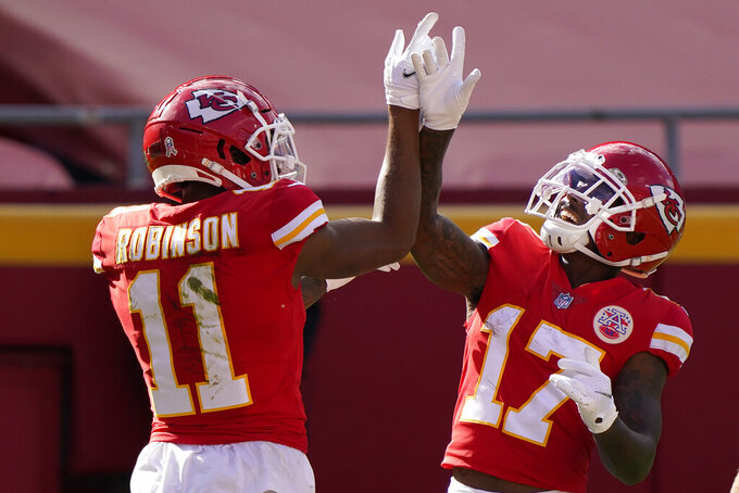 Kansas City Chiefs wide receiver Demarcus Robinson (11) celebrates after scoring a touchdown against the Carolina Panthers with wide receiver Mecole Hardman (17) during the first half of an NFL football game in Kansas City, Mo., Sunday, Nov. 8, 2020. (AP Photo/Jeff Roberson)